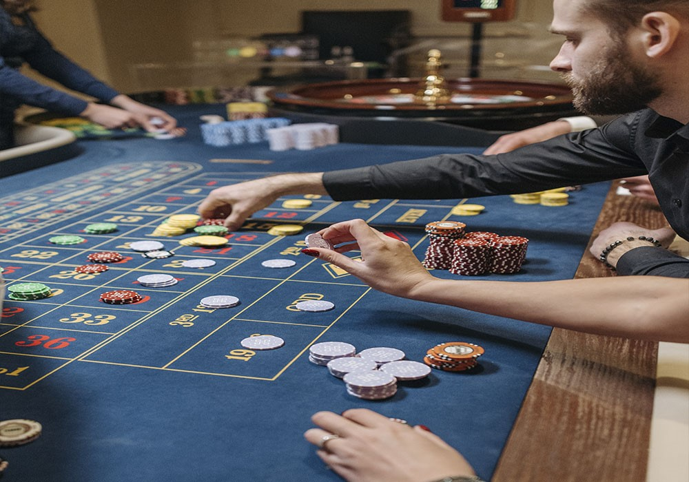A group fo people playing a poker game